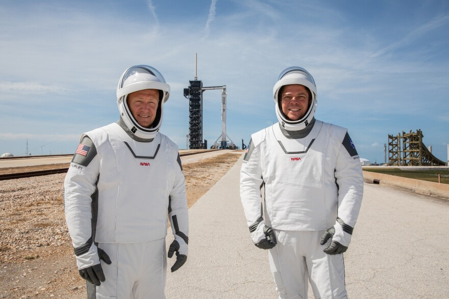 NASA astronauts Douglas Hurley, left, and Robert Behnken returned to Earth on Sunday after blasting off to the International Space Station in the SpaceX Crew Dragon spacecraft in May.