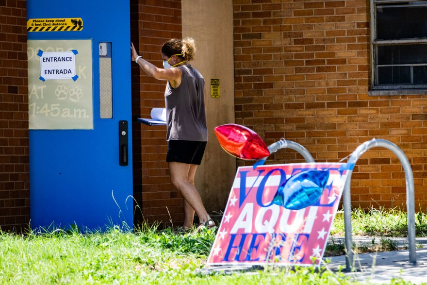 A voter enters the Joslin Elementary School polling place in Austin on July 14.