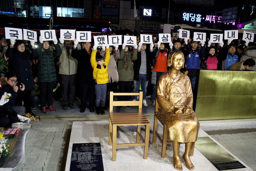 """A statue of a girl symbolizing Korean """"comfort women"""" is unveiled last week during a ceremony in front of the Japanese Consulate in Busan, South Korea."""