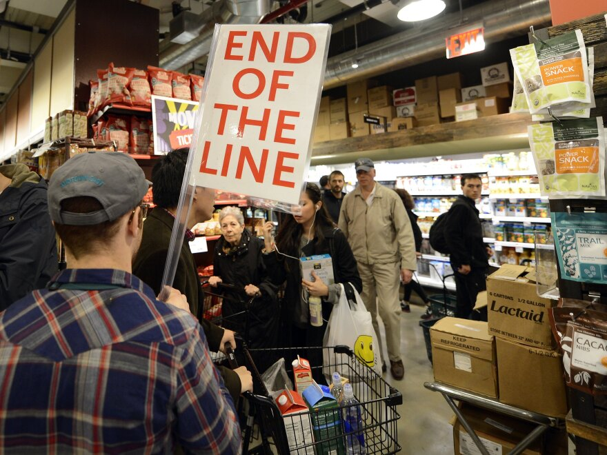 People try to get through the aisles at Whole Foods Market in Midtown in New York on Sunday before the storm.