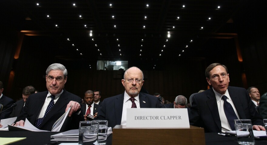 FBI Director Robert Mueller, Director of National Intelligence James Clapper and CIA Director David Petraeus appear before the Senate Select Committee on Intelligence on Capitol Hill on Tuesday.