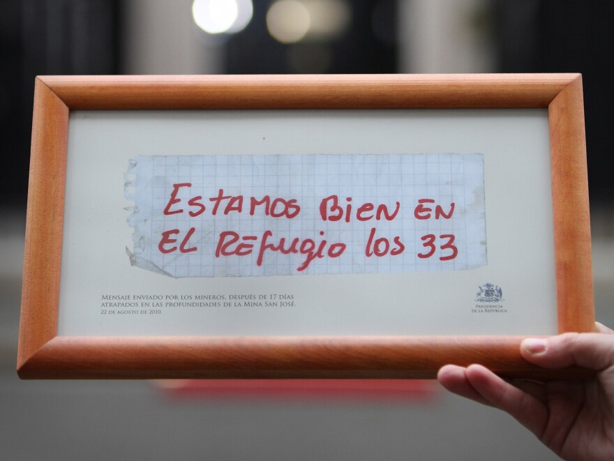 """A copy of the note sent from miners trapped in the San Jose mine. It reads: """"We are well in the refuge. The 33."""""""