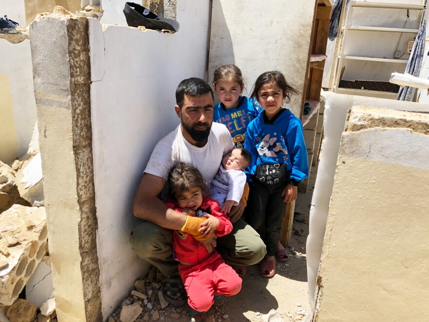"Ahmed Jumaa with his three children and niece. He and 14 family members fled to Lebanon from Syria six years ago. ""I built this house with my own hands, and I'm now destroying it with my own hands,"" he says."