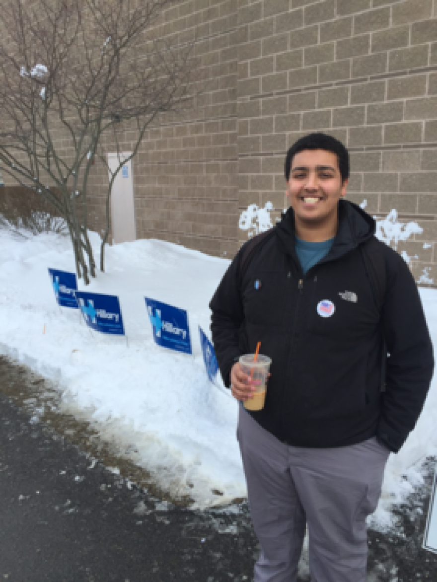 Simon Freitas, 19, poses outside the polling place at Oyster River High School in Durham on Tuesday, Feb. 9, 2016. Freitas, a 19-year-old sophomore at the University New Hampshire, voted for Bernie Sanders in the presidential primary because he likes Sanders' message of income equality and free college education.