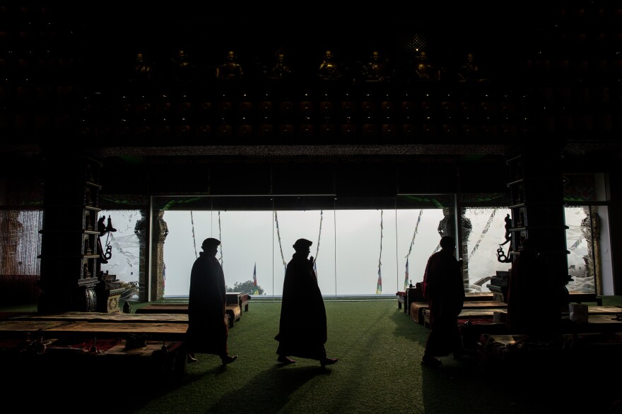 Nuns walk around a holy object — a practice known as kora — as part of their morning meditation.