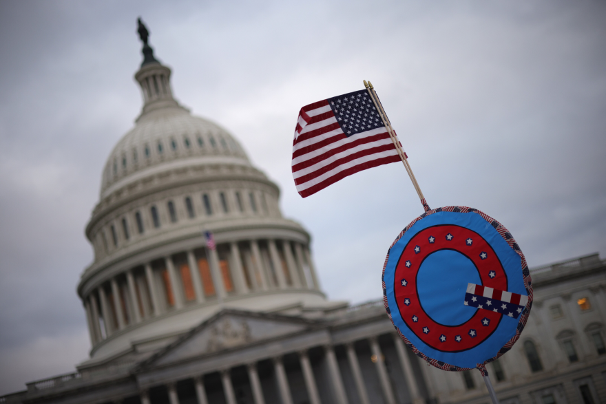 Supporters of former President Trump fly a U.S. flag with a symbol from the group QAnon as they gather outside the U.S. Capitol Jan. 06, 2021 in Washington, D.C. (Win McNamee/Getty Images)