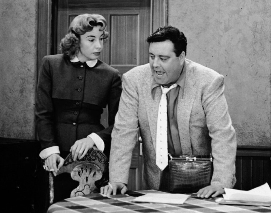Jackie Gleason (right) played Ralph Kramden — a bumbling but loveable overweight husband — in the 1950s sitcom <em>The Honeymooners</em>. Audrey Meadows co-starred as his wife, Alice.