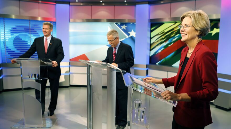 Massachusetts Republican Sen. Scott Brown (left) and Democratic challenger Elizabeth Warren before their first debate Thursday in Boston. At center is moderator Jon Keller.