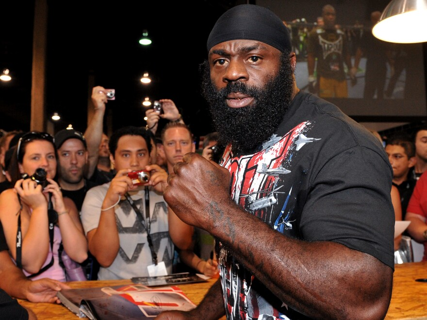 Kimbo Slice signs autographs at the UFC 100 Expo in Las Vegas in 2009. Slice died suddenly Monday at the age of 42.