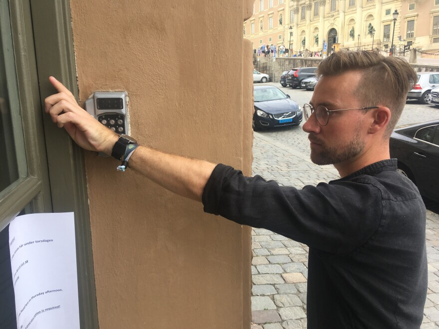 Erik Frisk, a Web developer and designer, uses his implanted chip to unlock his office door in Stockholm.