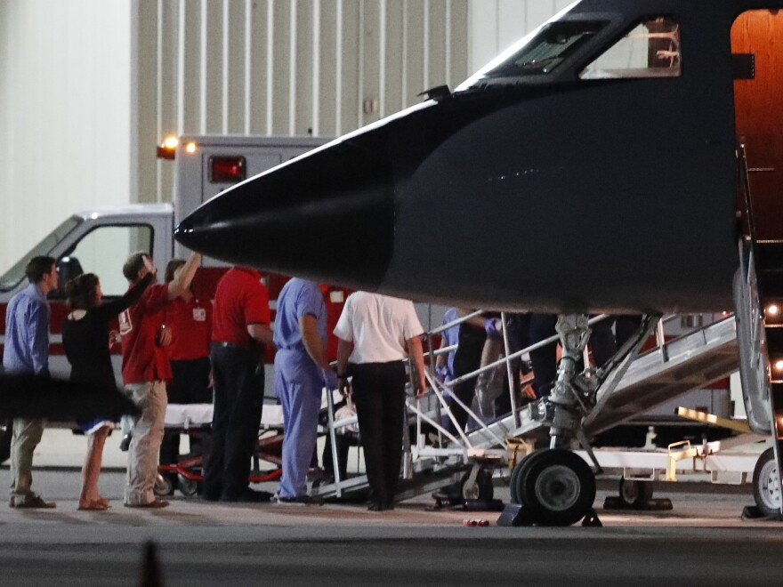 Otto Warmbier, a 22-year-old University of Virginia undergraduate who has been imprisoned in North Korea since January 2016, is transferred by medical personnel from a transport aircraft to an ambulance at Cincinnati Municipal Lunken Airport on Tuesday night.