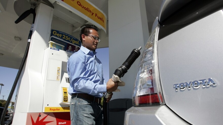 A driver pumps gas into his Toyota Prius hybrid at a gas station in Sunnyvale, Calif., in 2007.
