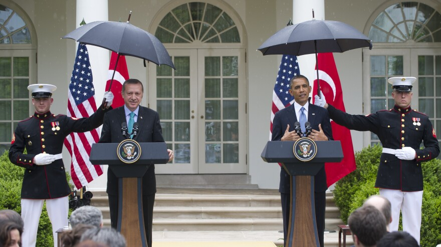 Rain fell Thursday during part of President Obama's joint news conference with Turkish Prime Minister Recep Tayyip  Erdogan in the Rose Garden of the White House.