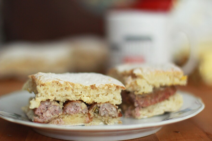 Fillings like this sausage are typically added after the blaa is taken out of the oven — as soon as possible!