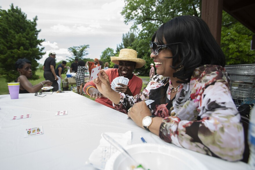 Barbara Coleman-Lyons and Dianne Holmes, members of Central Baptist Church, play Spades at the cookout.