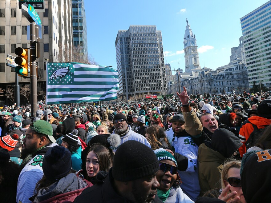 Philadelphia Eagles players and the city's mayor have responded forcefully to criticisms from the White House, after President Trump rescinded an invitation to celebrate their 2018 Super Bowl win at the White House. Here, Philadelphia Eagles fans line up in front of City Hall during the team's victory parade in February in Philadelphia.