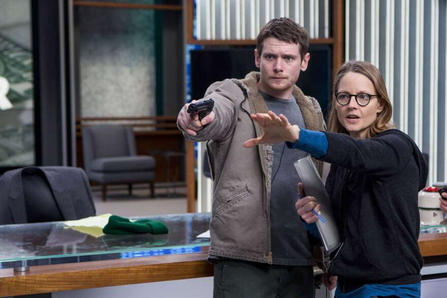 """Jodie Foster has found that directing allows her to realize a complete vision: """"It's a full expression of who I am and what I think,"""" she says. (Above) Foster works with actor Jack O'Connell on the set of <em>Money Monster.</em>"""
