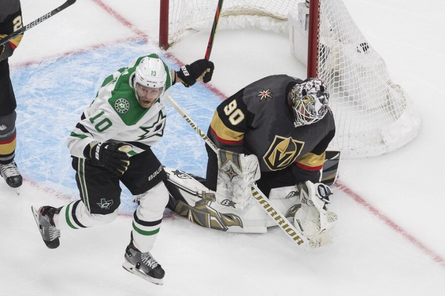 Dallas Stars' Corey Perry reacts as the puck goes in past Vegas Golden Knights goalie Robin Lehner on a goal by Denis Gurianov during overtime.