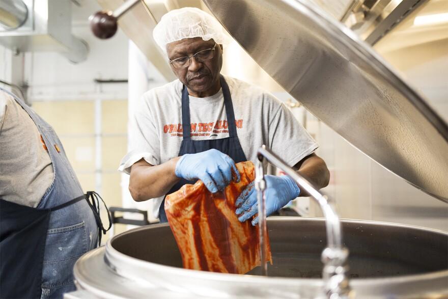 Freddie Lee James Jr., owner of Freddie Lee's Gourmet Sauces, prepares a batch of his mild sauce on Dec. 18, 2019 in St. Louis.