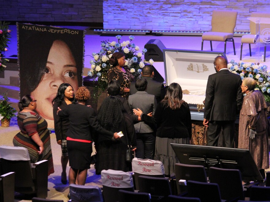Mourners gather around the casket of 28-year-old Atatiana Jefferson, who was fatally shot by a police officer earlier this month in Fort Worth, Texas. At her funeral on Thursday, family and friends remembered the impact she had on her community.