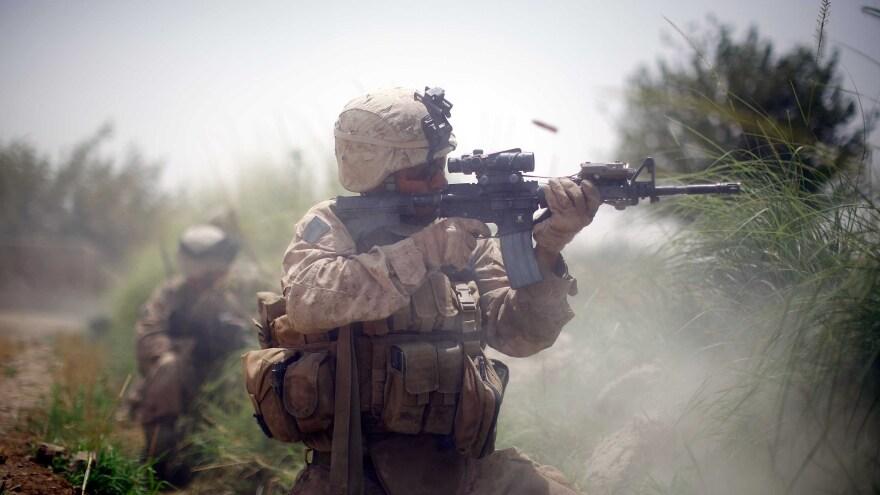 Marines wage a firefight in Mian Poshteh in July 2009.