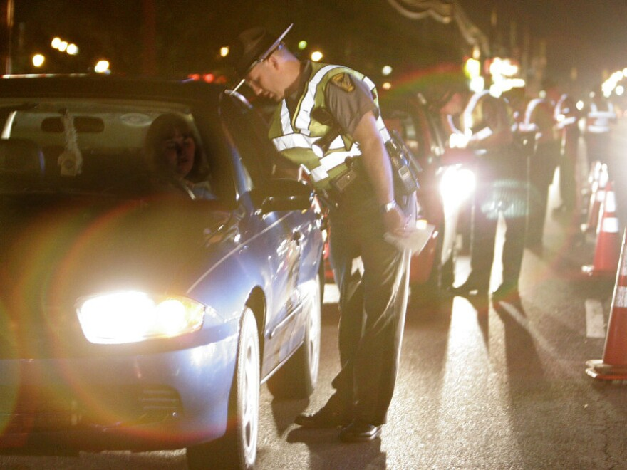 <p>Ohio State Highway Patrol troopers talk with motorists at a sobriety checkpoint in 2006, the year CDC says drunk driving peaked.</p>