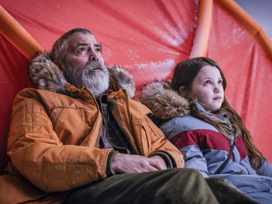 George Clooney and Caoilinn Springall, right, in a scene from the sci-fi film Clooney directed, <em>The Midnight Sky.</em>
