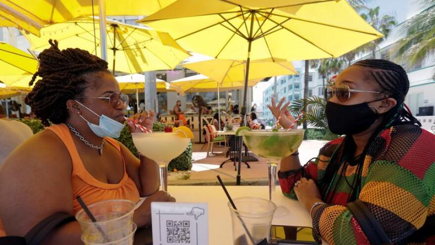 Customers chat as they drink in Miami Beach  this summer