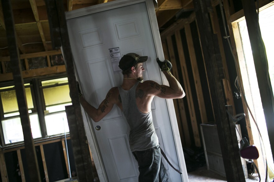 Blake Drummond works on a house in Springfield. Drummond was a high school dropout who went through a program at Opportunities for Individual Change. After getting his GED and taking construction and building classes, he now earns $21 an hour.