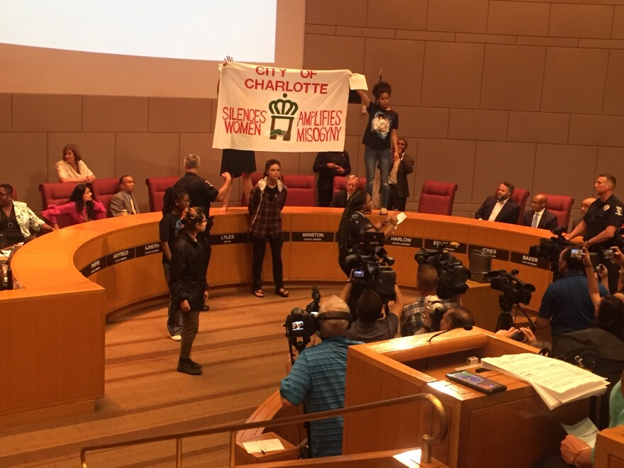 protesters at Charlotte City Council meeting