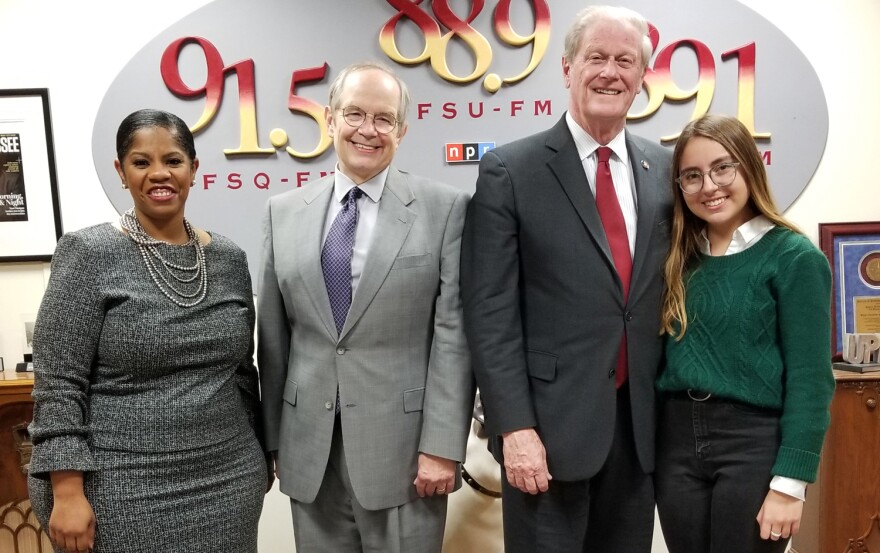 Tom and three guests standing in the fm lobby