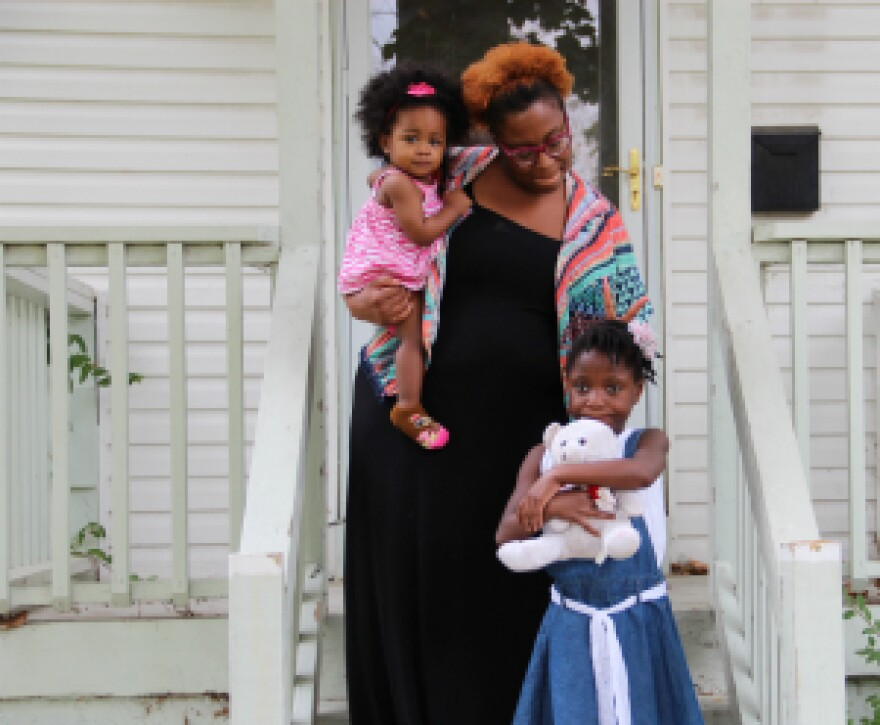 Shana Holliman is pictured here with her two youngest daughters, Corwren, who is 1, and 6-year-old Aleah. Last year Holliman pushed back against officials in the Ritenour School District who were suspending Aleah.