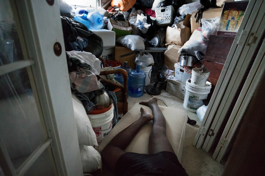 Ten evacuees from four different families are crowded into the six rooms of China Laguerre's home.