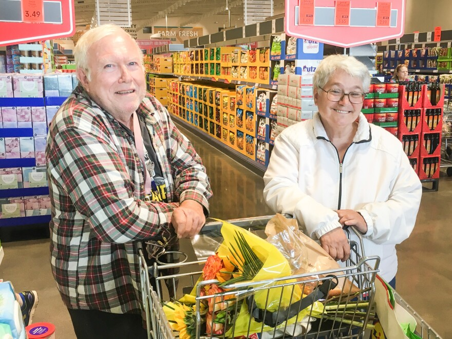 Roy and Rose Spilman camped overnight to be the first customers at a new Lidl store in Manassas, Va.