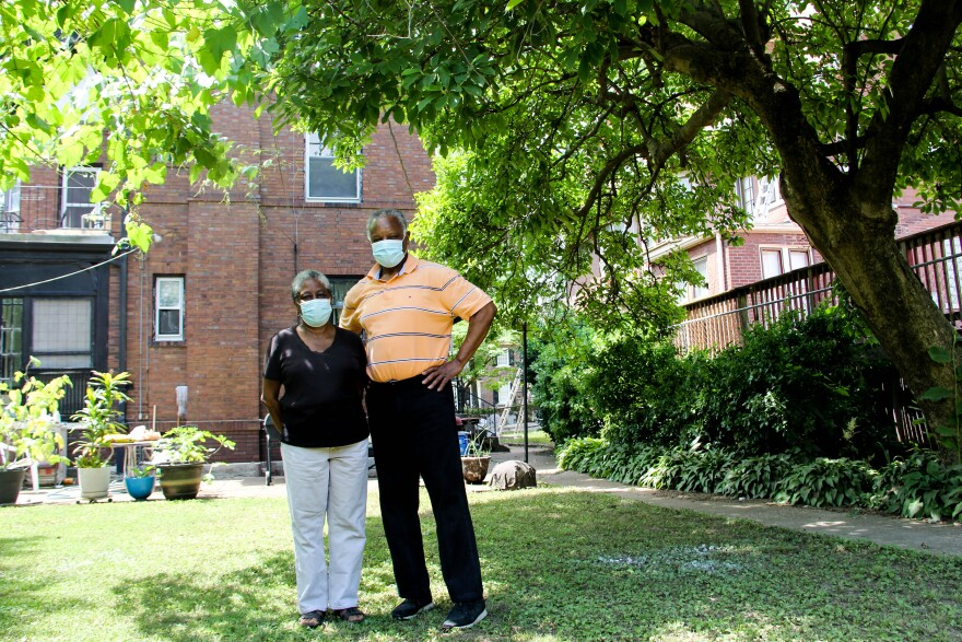 Tullia and Irvin Hamilton, residents of Visitation Park, standing in their backyard on June 19, 2020.