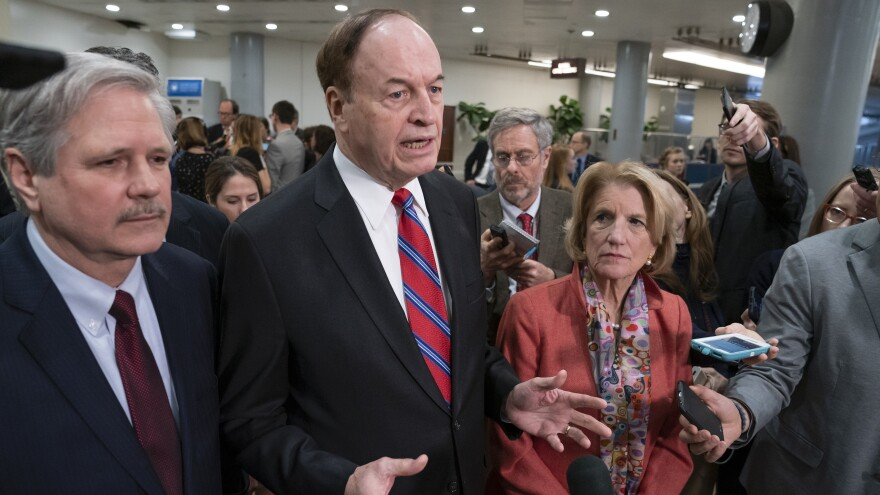 Sen. Richard Shelby (center), is the top Republican in a bipartisan group of lawmakers working to craft an agreement on border security.
