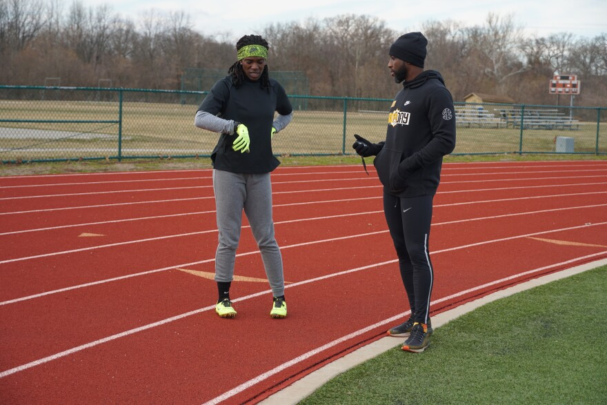Dawn Harper-Nelson discusses her run time during a session with her coach and husband, Alonzo Nelson Jr., who is also a track coach and math teacher at Belleville West High School in February 2020.