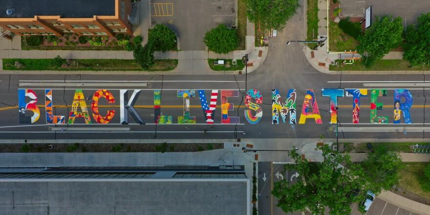 A bird's-eye view of a Black Lies Matter street mural in Minneapolis, Minnesota.