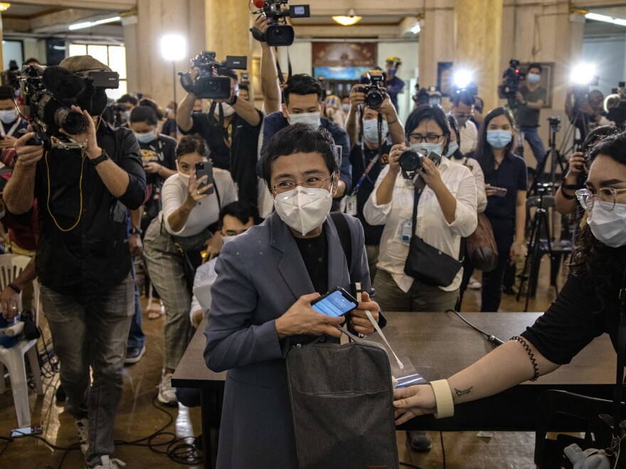 Maria Ressa, CEO of the Rappler news site, leaves a Philippine regional trial court after being convicted for cyber libel on June 15. Ressa, a veteran journalist and outspoken critic of President Rodrigo Duterte, is the focus of <em>A Thousand Cuts, </em>a documentary to be released virtually in the U.S. on Aug. 7.