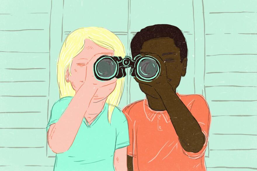 White kid and black kid looking through binoculars together