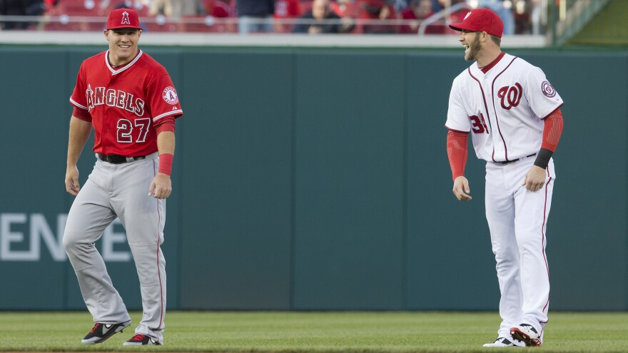 Los Angeles Angel Mike Trout (left) and Washington National Bryce Harper during warmups before the start of an April 2014 baseball game in Washington.