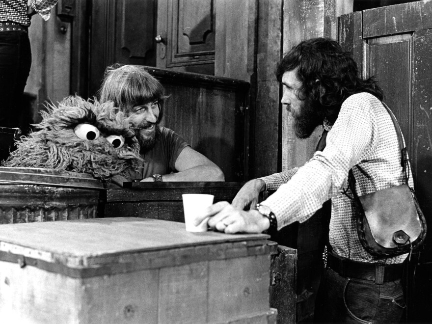 Caroll Spinney (left) with Jim Henson and Oscar in the 1970s.