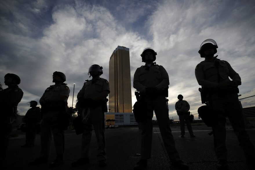 Police stand guard as protesters rally at the Trump Tower, Monday, June 1, 2020, in Las Vegas, over the death of George Floyd. (John Locher/AP)