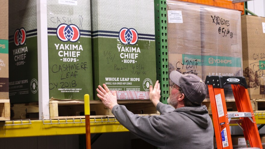"""At Odell Brewing Company in Fort Collins, Colo., Scott Dorsch pulls down a box of hops from the Yakima Valley in Washington, the state that grows the most hops in the nation. """"We would buy more hops than what Colorado could produce,"""" he says."""