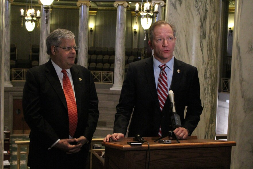Sens. Ron Richard, left, and Bob Onder, right, speak at Thursday press conference. Onder handled a House bill that would set curbs on when lawmakers could become lobbyists.