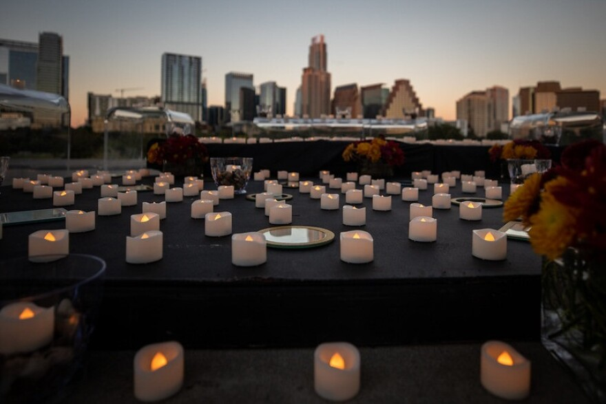 A candle tribute to individuals who lost their lives to the COVID-19 pandemic in Travis County is set up outside of the Long Center in Austin, Texas.