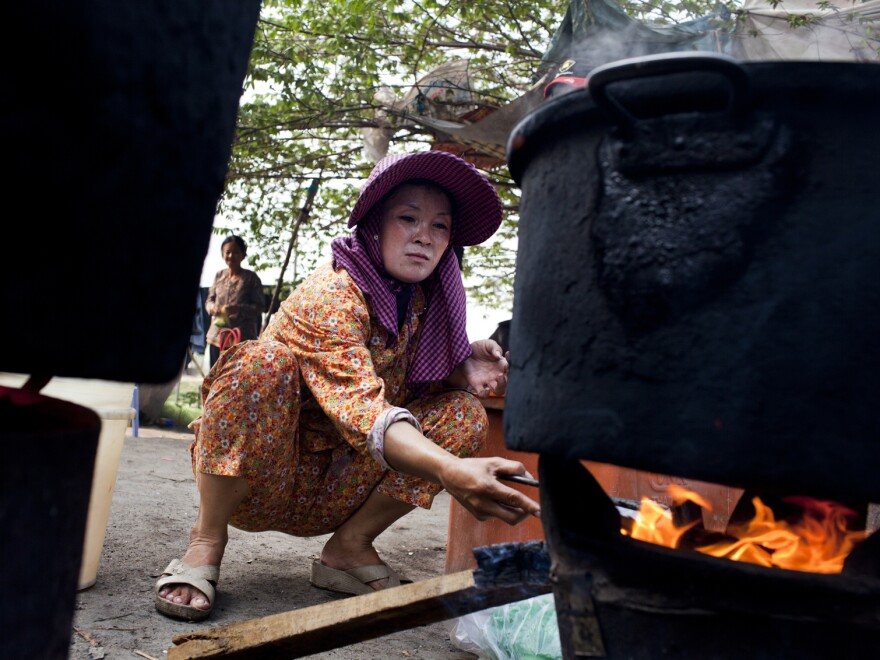 Sriv Keng, 39, makes soup to sell at her street stall.