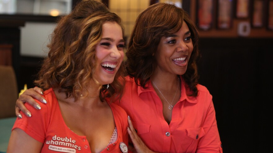 Maci (Haley Lu Richardson) and Lisa (Regina Hall) share a laugh in the workplace comedy <em>Support the Girls</em>.