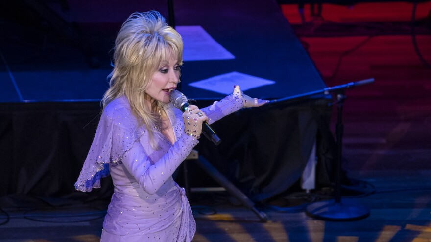 Dolly Parton will read children's books on a video stream once a week, drawing titles from her Imagination Library. She's seen here performing in Nashville, Tenn., in January.