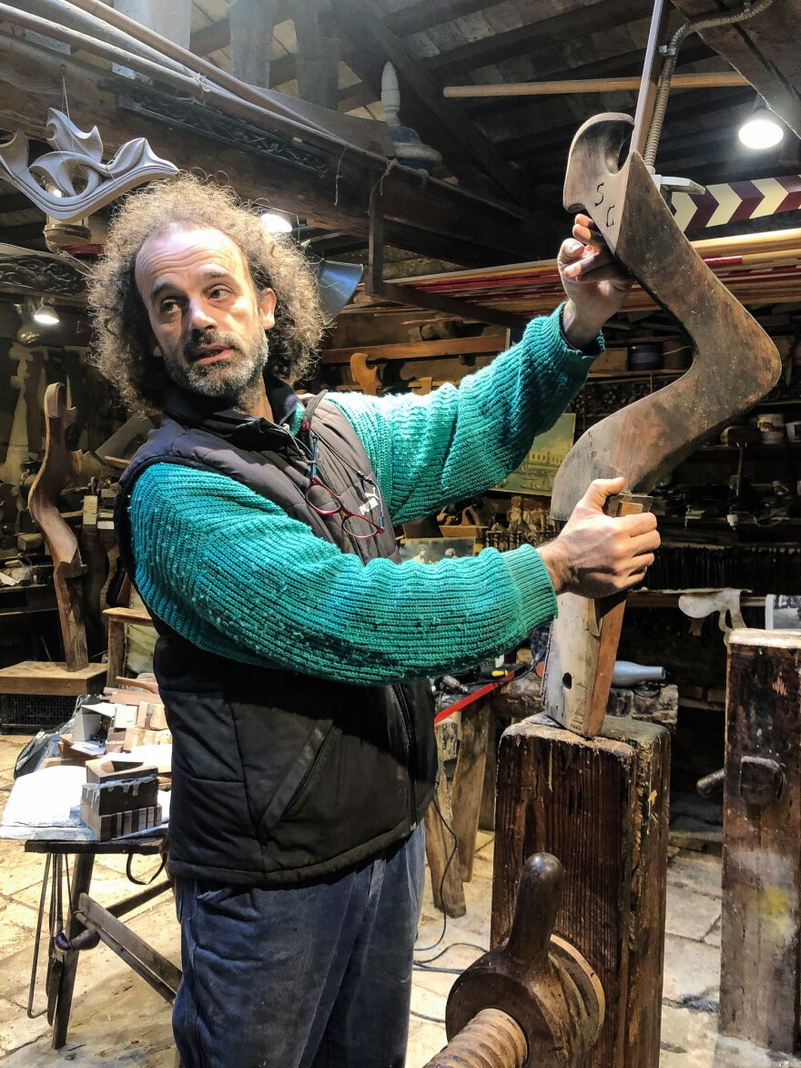 Master artisan Paolo Brandolisio, one of only four remaining makers of oars and oar posts for the city's legendary gondolas, is trying to put his workshop back in order after the floods.